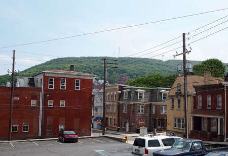 POTTSVILLE, PA - JUNE 8: A view across the small mountain town of Pottsville, Pennsylvania, with the famous Yuenglings beer factory nestled in the mountainside overlooking the city on June 8 2015.