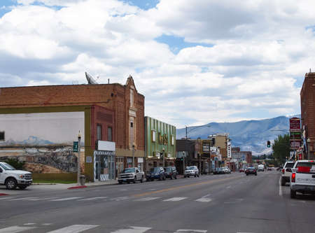 ELY, NEVADA - JULY 23, 2018: Businesses in early 1900s buildings lines the sides of Aultman St. on a section of the famed Lincoln Highway, also Route 50, in downtown Ely, Nevada..