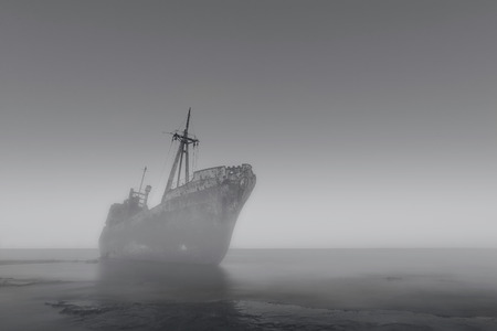 ship wreck: The Ghost Ship breaking through the Mist