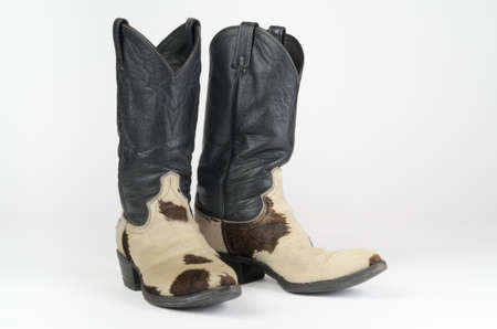 things that go together: Cow Hide Cowboy Boots Stock Photo
