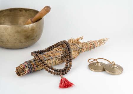 Singing Bowl, Smudge Stick, Prayer Beads and Meditation Bells.