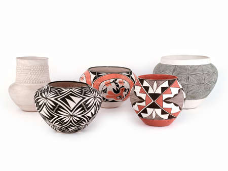 Five Pieces of Antique Native American Pueblo Pottery isolated on white background. Stock Photo