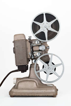 mm: Side view of Vintage 8 mm Movie Projector with Film Reels. Film is threaded through Projector.