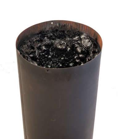 creosote: Dangerous accumulation of Creosote in a Wood Stove Chimney Pipe. Stock Photo