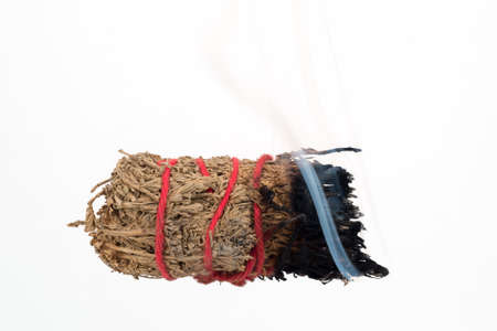 smudge: Burning Smudge Stick used for purification. Stock Photo