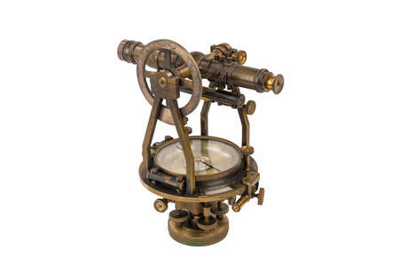 land surveyor: Vintage Brass Surveying Level Transit, Theodolite with Compass and natural aged Brass Patina, focus stacked and isolated on white background. Stock Photo
