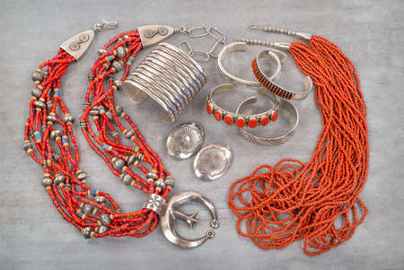 indian artifacts: A Collection of Silver, Coral and Glass Bead Native American Jewelry. Stock Photo