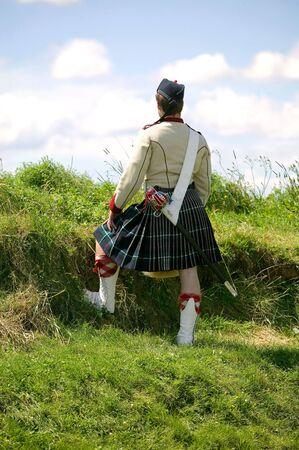 highlander: Highlander permanente en colina
