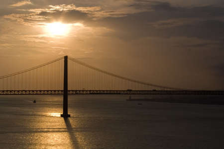 Bridge 25 de Abril over Tagus river  in Lisbon at sunset