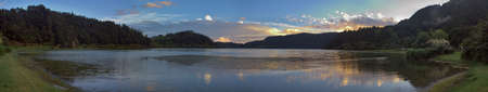 Panoramic view of Furnas Lagoon from water level and close to sunset. Azores, Portugal