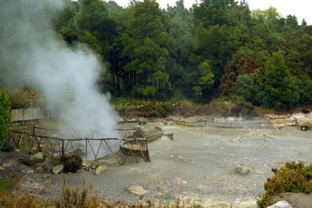 Fumaroles throwing smoke, steam and boiling water out of the earth near Furnas Lagoon. Azores, Portugal Stock Photo