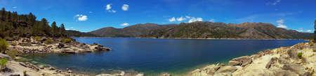 Water edge at lake of Vilarinho das Furnas dam. Gerês National Park, Portugal. Stock Photo