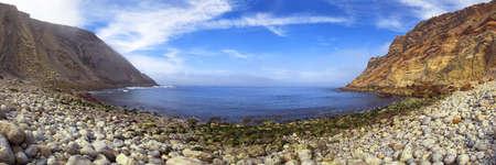 The small Lagosteiros Beach (Praia dos Lagosteiros) of stones and boulders next to Espichel Cape, Sesimbra, Portugal