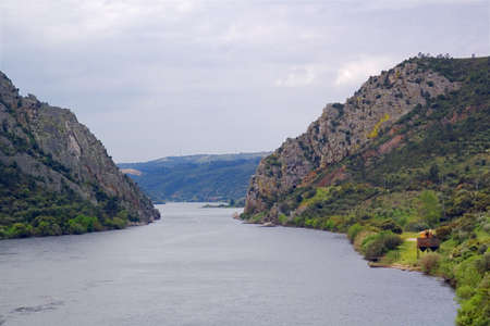 Tagus river goes through a narrow passage at Portas do R�d�o. Closeup View. Portugal