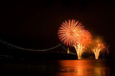 Fireworks over Tagus river near April 25th bridge. Lisboa, Portugal