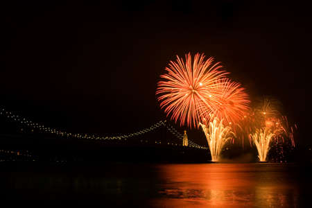 Fireworks over Tagus river near April 25th bridge. Lisboa, Portugal
