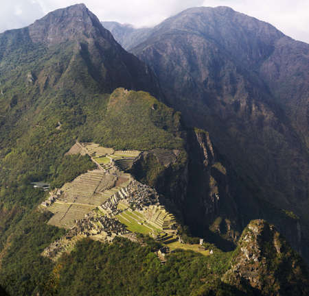 Machu Picchu and mountains seen from Wayna Picchu, the oposite direction. Slight mist.