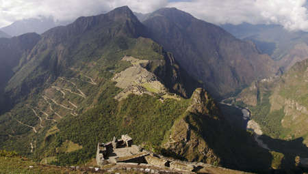 Machu Picchu and mountains seen from Wayna Picchu ruins. Road to Águas Calientes.