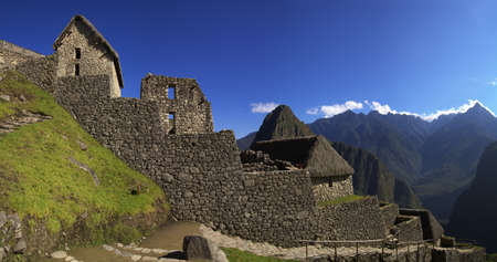 First ruins that are seen after entering Machu Picchu through the main entrance.