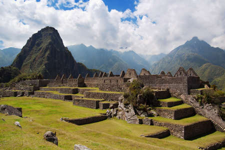 Three Doorway group of ruins width Wayna Picchu in background, Machu Picchu. photo