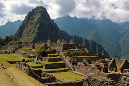 Three Doorway group framing Wayna Picchu in Machu Picchu. Stock Photo