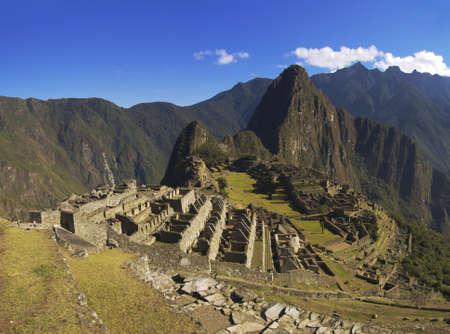 Machu Picchu inca city by the morning soft sunlight.