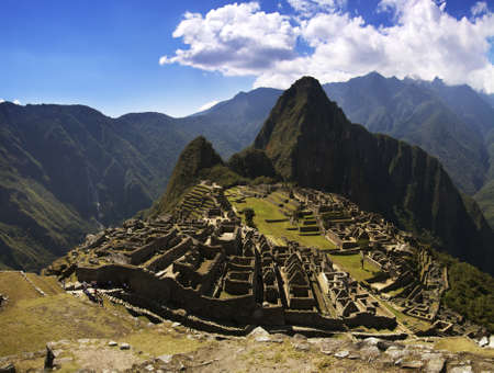 Machu Picchu inca city in the afternoon strong and harsh sunlight. Stock Photo