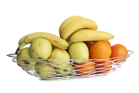 A fruit basket of metal wire isolated on white, profile view. Stock Photo
