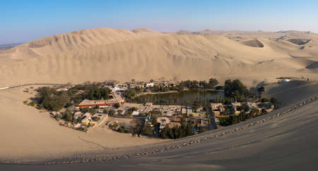 Panorama of Huacachina oasis in Ica desert, Peru. Stock Photo