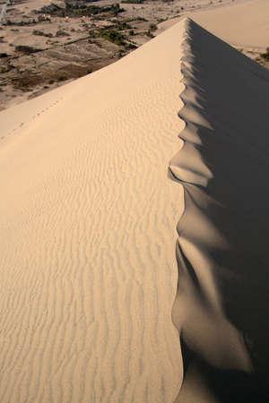 Untouched sand dune crest of Ica desert, Peru.