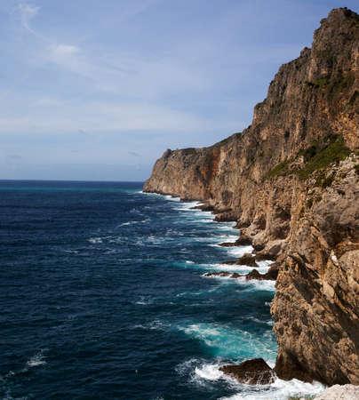 Cape Espichel south cliff, breaking waves. Sesimbra, Portugal. Stock Photo - 9417232