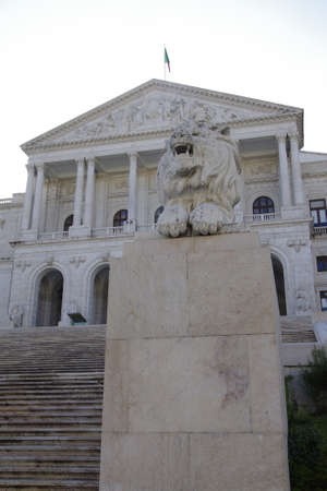 Portuguese parliament building and lion stone statue. Lisboa, Portugal.