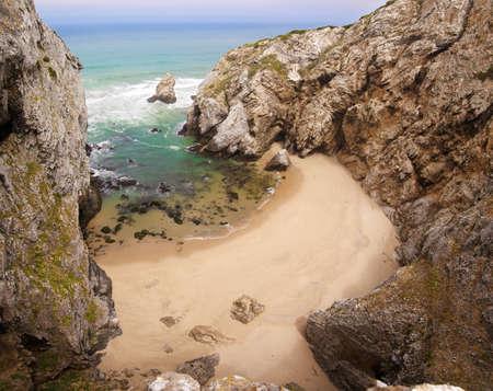 inaccessible: A small, inaccessible, deserted beach near Cabo da Roca. Sintra, Portugal. Stock Photo