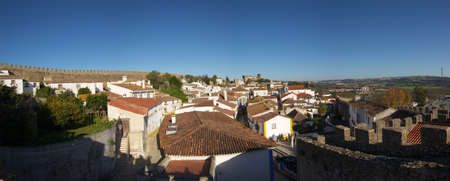 Low angle panoramic view of the walled town of Óbidos, Portugal. Stock Photo