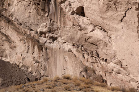 Colcas (or Qolcas) escavated and built in the mountain wall used as food storage and as tombs. Colca Canyon, Peru.