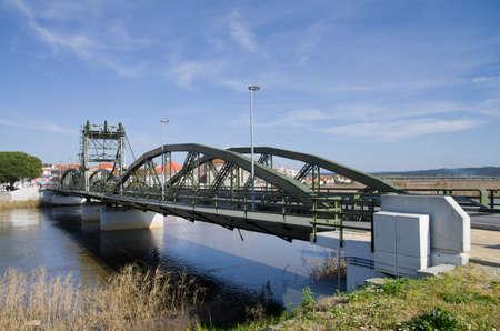 Metal structure elevation bridge over Sado river. Alcacer do Sal, Portugal.