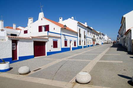 Porto Covo town main pedestrian street of white houses. Sines, Portugal.
