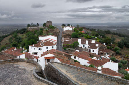 São Bento Chapel, outside the of the walled town of Monsaraz under an overcast sky. Alentejo, Portugal.