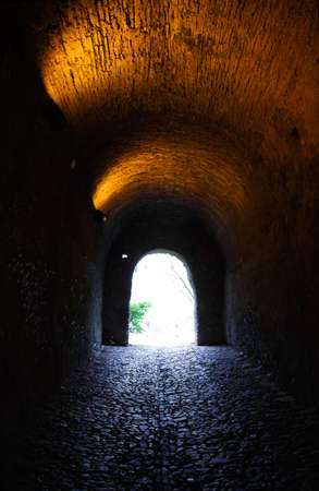 Light at the end of an old stone tunnel  Castelo de Vide, Portugal