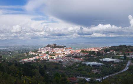 Overview of Castelo de Vide under an overcast heavy sky  Alentejo, Portugal  Stock Photo