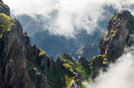 Mountain hiking trail through the ridge between two peaks going from Pico do Areeiro to Pico Ruivo  Madeira, Portugal