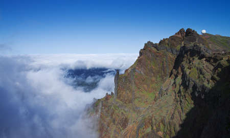 Pico do Areeiro towering over an ocean of clouds  Madeira, Portugal  Stock Photo