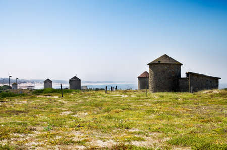 converted: Traditional windmills converted to bungalows facing the ocean besides Apulia beach  Esposende, Portugal