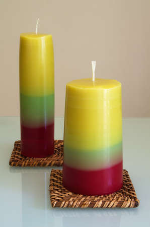 Two tricolored hand made candles. Series on making craft candles. Stock Photo
