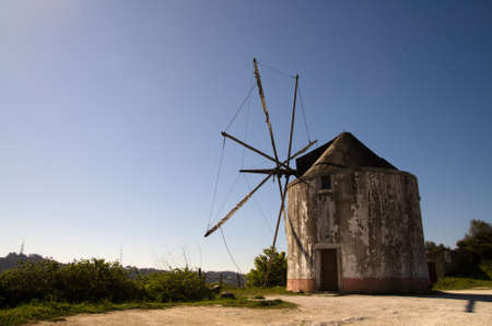 traditional windmill: Old and abandoned traditional windmill. Palmela, Portugal. Stock Photo
