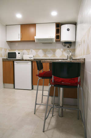 refrigerator kitchen: Renewed small kitchen. Counter with high chairs. Cupboards, small refrigerator, microwave oven, fumes extractor and water heater.