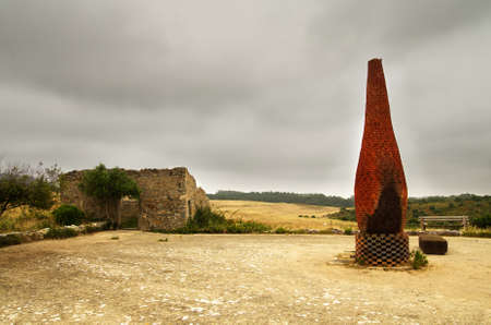 red clay: Traditional furnace or oven built of red clay to dry cereals in outdoor environment. Sintra, Portugal.