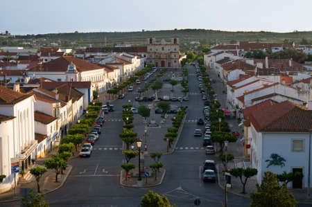 Central main square of Vila Vicosa. Actually a large avenue with the main church at one end and the castle at the other. Alentejo, Portugal.