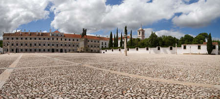 Facade of Paco Ducal, the Ducal Palace and most famous monument of Vila Vicosa. It started to be built in 1501 and served many portuguese Kings, one of them D. Joao IV portrayed in the statue at the middle of the square. Alentejo, Portugal.