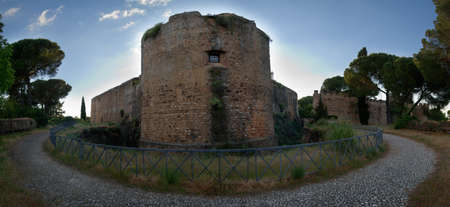 Panorama of outer walls of Vila Vicosa Castle with round towers and surrounded by a security pit. Alentejo, Portugal.